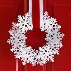 Easy Christmas wreath. Pre-made snowflake ornaments (dollar stores have them), glued on to a flat foam wreath.