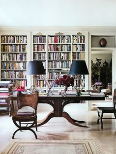 Books, books, books - how fabulous this bookcase, table and chairs.... classic
