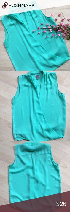 """Nordstrom mint green wrap sleeveless blouse Mint green wrap style tank top blouse. Purchased at Nordstrom; in like new condition. Wrap top stays fasted with one small snap. ~38"""" bust and 23"""" long. Chelsea 28 Tops Tank Tops"""