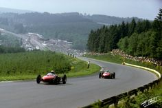 Hill-Rodriguez 1962 Belgium Up the hill from Eau Rouge corner, Phil Hill and Ricardo Rodriguez race their shark nose Ferraris in the 1962 Belgian GP.