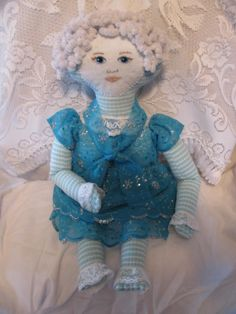 This is a full view of Mary Jane.  She is about 15 inches tall.  I made her body out of a child's blue and white knit shirt which I found at Goodwill.  She was a design as you go doll LOL.  But then most of my dolls are that way.  OOAK's