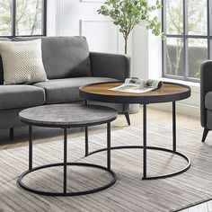 Forest Gate Farmhouse 2-Piece Round Nesting Coffee Tables In Grey Barnwood - The sleek, modern 2-Piece Farmhouse Nesting Coffee Tables by Forest Gate provides you additional surface space as needed. Perfect for entertaining. Round tops and bases with wooden tabletops and open metal bases.