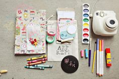 Travel Art Kit: make a scrapbook on the go instead of when you get home!!!! I seriously NEED this mini instant camera!!!