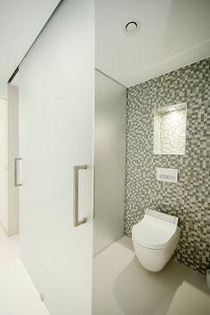 Germany-based interior design studio Hennings Börn Interiors designed Villa Dreieichenweg, a contemporary residence located in Hamburg, Germany. Beautiful Bathrooms, Modern Bathroom, Sandblasted Glass, Villa, Interior Design Studio, Bathroom Inspiration, Bathroom Ideas, Architect Design, Glass Panels
