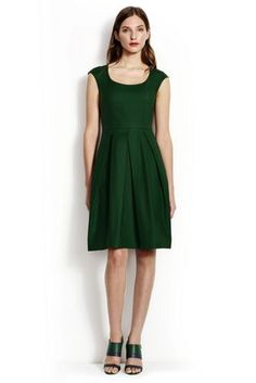I like the color, the scoop neck, and the box pleats. I like that it is not quite a tank but not quite cap-sleeved either.