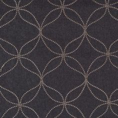 We love this fabric, with its raised and embroidered dots in a classic geometric pattern. It looks and feels like a menswear lightweight wool, though it's a polyester. A sophisticated home fabric in onyx gray that works well in contemporary rooms as curtains, pillows, light upholstery and more.