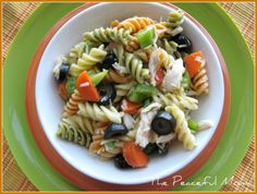 Italian Chicken Pasta Salad  16 oz. box of garden rotini    2 cups shredded baked chicken    1/2 yellow or red onion, chopped    1 green pepper, seeded and diced    2 small carrots, diced    15 ounce can sliced pitted black olives    1/2 tablespoon salt    1/2 tablespoon dried basil    1-2 cups Italian Salad Dressing (depending on taste)