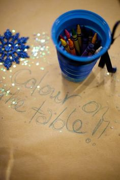have a table for the kids with fun stuff to do while the parents enjoy themselves- i also like the idea of paper covering the tables and crayons to write with! :)