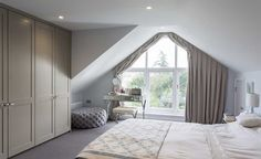 A rear extension with feature gable window makes an impact in this space