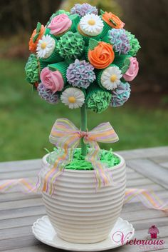 Cupcake topiary. Full tutorial available in goodtoknow Recipe Magazine out on Thursday the 6th Feb or on your iPad - just search goodtoknow recipes March edition :-)