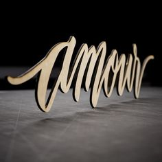 Laser cut calligraphy by @paperglazecalligraphy. #lasercut  #calligraphy #amour #handwritten #lasercutting