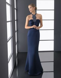 Image from http://wedding-pictures.onewed.com/match/images/47023/navy-blue-bridesmaid-dress-elegant-statement-neckline.original.jpeg?1379136410.