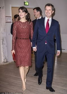 Crown Princess Maryoozed elegance in a plum floral lace dress by Dolce and Gabbana teamed...