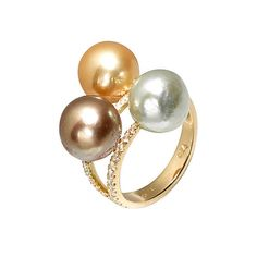 Fresh pearl creations by Yvel. Three 9 to 11 mm multicolored fresh water pearls float on rows of glittering diamonds (.45 ctw), all set in 18k yellow gold.