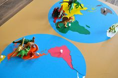 Dinosaurs on the Map Montessori- This could be done with all kinds of animals-- so clever!