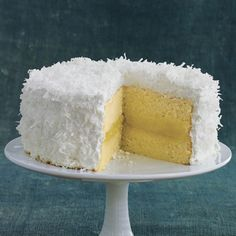 Fresh Lemon-Coconut Cake  Years ago my mom used to buy a lemon coconut cake from the frozen aisle at the store. I think it might have beebn Pepperidge Farms. It was totally delicious. I can just imagine how wonderful that same one would be made from scratch! Yum!