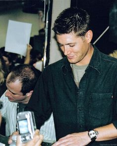 Jensen and Eric Kripke signing autographs at Comic-Con 2007
