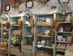 Beautiful!  Gift Shop Magazine  www.giftshopmag.com  Large shelving unit..styling and comingle crates flat or standing up
