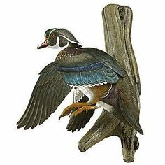 """Dropping in"" Flying Wood Duck Wall Mount Sculpture by Woodside Gardens. $139.13. A tradition of craftsmenship...how each decoy is created.  All Loon Lake Decoy Company Waterfowl Decoys, Upland Bird Sculptures and Framing Cameos start as an original solid Tupelo Gum or Basswood wood carving by Master Carver Sam Nottleman. From each original, a mold is made which the hand-cast reproductions are then pulled.  A variety of casting mediums along with a resin binder are used to..."