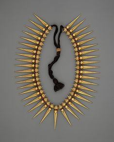 *Jasmine-Bud Necklace (Malligai Arumbu Malai).  India (Tamil Nadu and Kerala)  Medium: Gold with rubies strung on black thread.  19th century