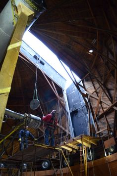January 28, 2014 - The first piece of the Clark Telescope, a counterweight, is lifted out of the dome by crane.