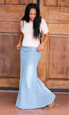 A modest stone washed light denim skirt with front and back pockets, a mermaid fit and flare style and front zipper available in S-XL