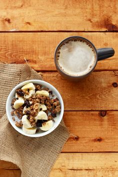 Love Crunch Dark Chocolate & Peanut Butter Granola with sliced banana, a little extra dark chocolate, and soy milk + coffee with vanilla soy milk.