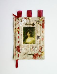 """Fabric Wall Hanging with Woman's Portrait on an Ivory and Red Cabbage Rose Background? 9"""" x 17"""""""