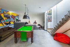 Cool basement space for kids.  Love the tier seating for sleepovers, movies and video games.  Also love the glass with sliding door at the bottom for noise control!