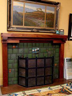 Arts and Crafts tiles surround a fireplace, with a Greene & Greene style wood mantle.