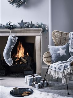 This scene makes us feel all Christmassy. Love the cosy look of the grey fabric with stars against the warm glow of the fire. Can imagine friends and family sitting around relaxing and having fun #FeelNomNom