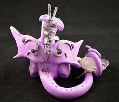 Handmade Polymer clay dragon with quartz crystal and quartz needles.