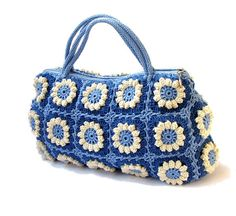 Flower crochet handbag crochet bag in navy blue and by zolayka, $90.00  http://www.etsy.com/treasury/MTAzNTMyODV8MjY0ODQwMDkyMg/blue-feeling