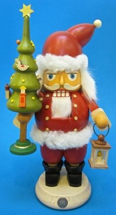 traditional Christmas German wooden nutcracker: Santa with Tree