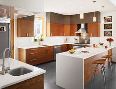 """""""The cabinets were a cost-driven solution,"""" Moss says. """"The kitchen was developed around Ikea cabinet boxes, but we sourced the semi-custom cabinet front panels through an online retailer, 27estore.com."""""""