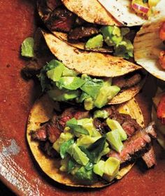 Citrus-Marinated Steak Tacos - serve with avocado lime salsa from Real Simple