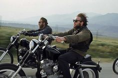 Hell's Angels riding motorcycles on road