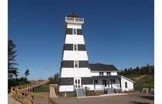 Sleep in a lighthouse! - Westpoint PEI - Inn and Museum. Agricultural Land, Prince Edward Island, Anne Of Green Gables, The Dunes, Nova Scotia, Oh The Places You'll Go, Willis Tower, Lodges, East Coast