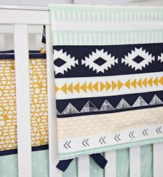 Keep baby warm in Caden Lane's trendy new Aztec Gold and Mint print blanket!