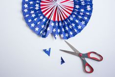 Fourth of July Fireworks Wreath – of July – Grandcrafter – DIY Christmas Ideas ♥ Homes Decoration Ideas 4th Of July Fireworks, Fourth Of July, 4th Of July Wreath, Holiday Crafts, Christmas Diy, Straw Wreath, 4th Of July Decorations, Paper Fans, Wreath Forms