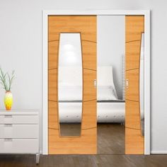 Double Pocket Elements Sol Oak sliding door system in three size widths with clear glass. #intemalpocketdoors #contemporaryinternaldoors #contemporaryroomdividers
