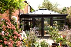 Would you love to extend your home and bring in more space and light? If so, a conservatory could be the perfect option for you! This sleek brown extension complements the traditional red brick home perfectly. Conservatories, Extra Rooms, Red Bricks, Dark Night, Interior Inspiration, Cosy, Gazebo, Buildings, Workshop