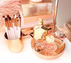 Beauty vanity, beauty vanity goals, rose gold, copper, gold, makeup brushes, DIY brush holder, storage tips, makeup storage tips, perfume, Peach, blush pink, fluffy.