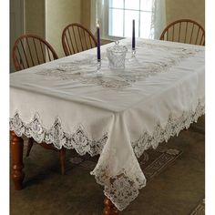 The one and only Violet Linen Imperial Embroidered Tablecloth is the perfect item to decorate your table with, and add grace and style to its interiors. This elegant tablecloth is a must have if you wish to make an impression on all your guests.