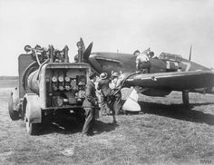 Groundcrew refuelling a Hawker Hurricane Mk I of No. 32 Squadron from a refuelling truck whilst the pilot waits in the cockpit, Biggin Hill, August 1940. (IWM)