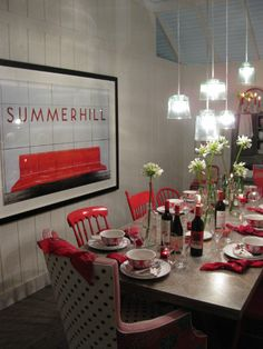 A red-and-white dining room by HGTV star Sarah Richardson and Rich Brilliant Willing designer Theo Richardson at the 2011 Interior Design Show. The eclectic dining room table features mix and match chairs all in red.