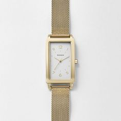 This rectangular Hagen features three-hand movement, metallic indexes and numbers along the top and bottom of the sandblast dial. The watch is finished with a 14mm steel-mesh strap.