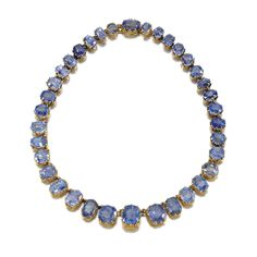 SAPPHIRE RIVIÈRE, LATE 19TH CENTURY Designed as a graduated series of mixed-cut sapphires within stylised Fleur-de-Lys claw-settings, length approximately 360mm.