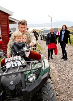 Crown Prince Frederick shows an atv to twins Prince Vincent and Princess Josephine as their mom Crown Princess Mary looks on, Greenland, August 1, 2014