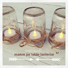 Invert mason jars with battery operated candles inside lids, decorate with twine, use in a grouping for more impact